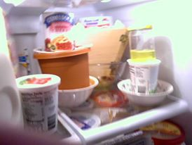 Pascha cheese in the refrigerator under weights.